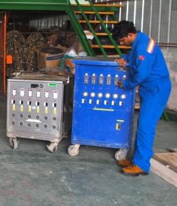 Technician_adjusting_temperature_recorders.med.jpg